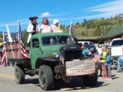 Thumb Nail view of the green Dodge Power Wagon, the un-Official truck of Constitution Week advertising the Constitution Week Event in Grand Lake, Colorado  with patriots throwing candy; click here to open a window with a larger picture.