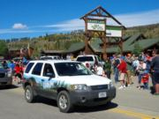 A thumb nail view of Grand Lake, Colorado during Constitution Week in September looking at a Park Ranger driving the Rocky Mountain National Park SUV in the Parade; click here to open a window with a larger picture.
