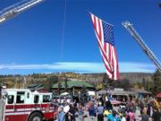 A thumb nail view of Grand Lake, Colorado during Constitution Week in September looking at the Garrison Flag hung over the parade route as the parade is in progress; click here to open a window with a larger picture.