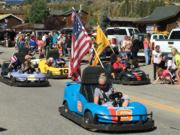 A thumb nail view of Grand Lake, Colorado during Constitution Week in September looking at the Scorpion King Go Carts as they go down Grand Avenue in the Parade; click here to open a window with a larger picture.