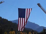 A thumb nail view of Grand Lake, Colorado during Constitution Week in September looking at the large Garrison Flag that hangs over Grand Ave. on parade day; click here to open a window with a larger picture.
