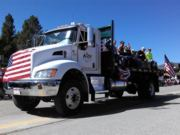 A thumb nail view of Grand Lake, Colorado during Constitution Week in September looking at the Alpine Lumber Truck rolling along Grand Ave. in the parade; click here to open a window with a larger picture.