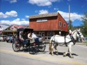 A thumb nail view of Grand Lake, Colorado during Constitution Week in September looking at a horse and buggy infront of the Boot Hill store; click here to open a window with a larger picture.