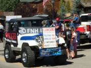 A thumb nail view of Grand Lake, Colorado during Constitution Week in September looking at the C & M Guns Jeep supporting our 2nd Amendment; click here to open a window with a larger picture.