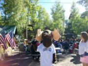 A thumb nail view of Grand Lake, Colorado during Constitution Week in September looking at Bruce the Grand Lake Moose standing at a Pegg Mann concert; click here to open a window with a larger picture.