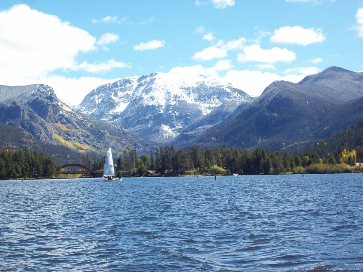 Slide 1 - Picture of Sail boat looking down the channel from Shaddow Mountin Lake to Mt. Craig (Baldy) covered in snow in this fall picture taken in Grand Lake, Colorado