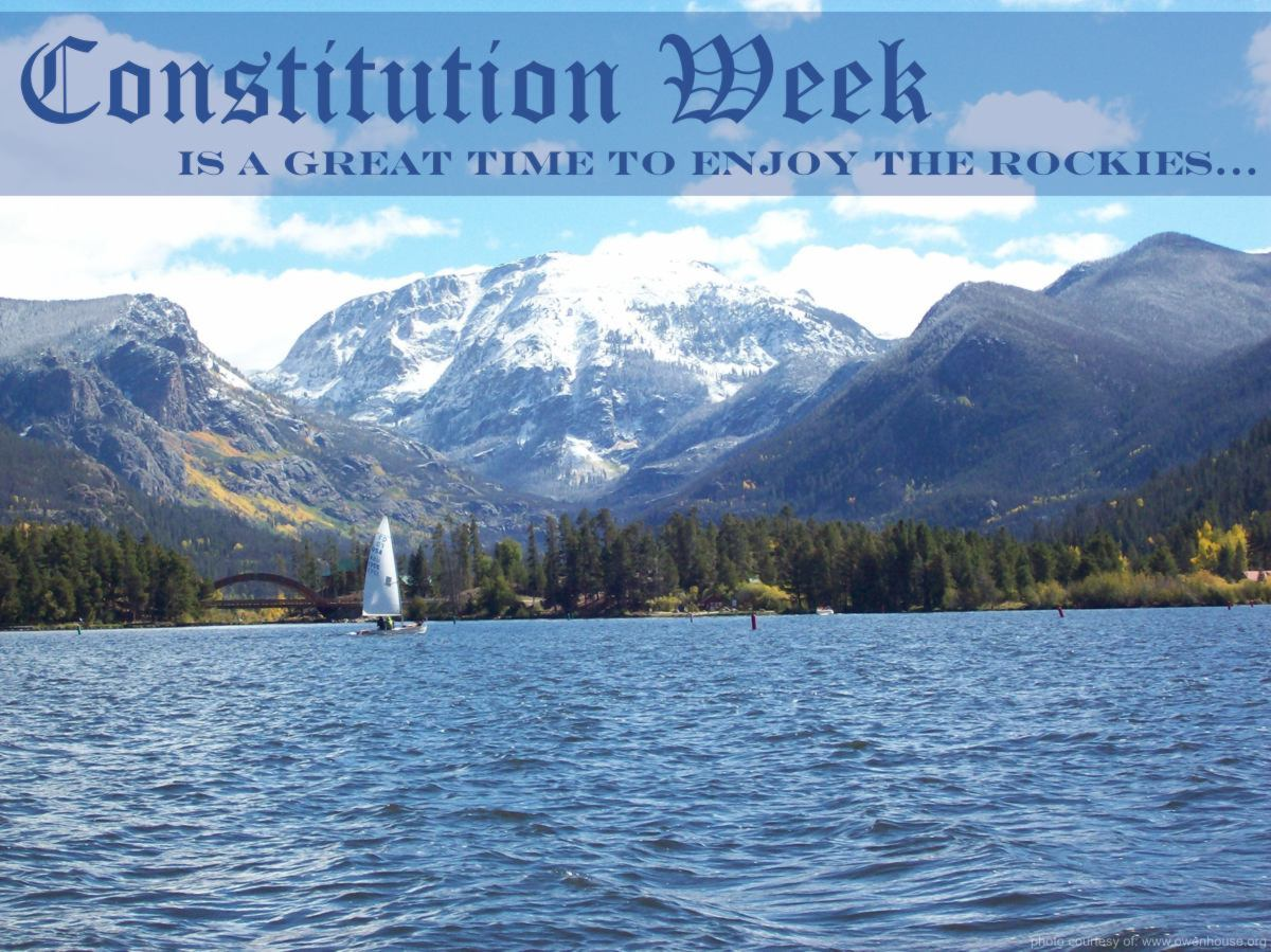 Slide 2 - Picture of Sail boat looking down the channel from Shaddow Mountin Lake to Mt. Craig (Baldy) covered in snow in this fall picture taken in Grand Lake, Colorado - Now with text supporting Constitution Week and why you should be here in the fall.