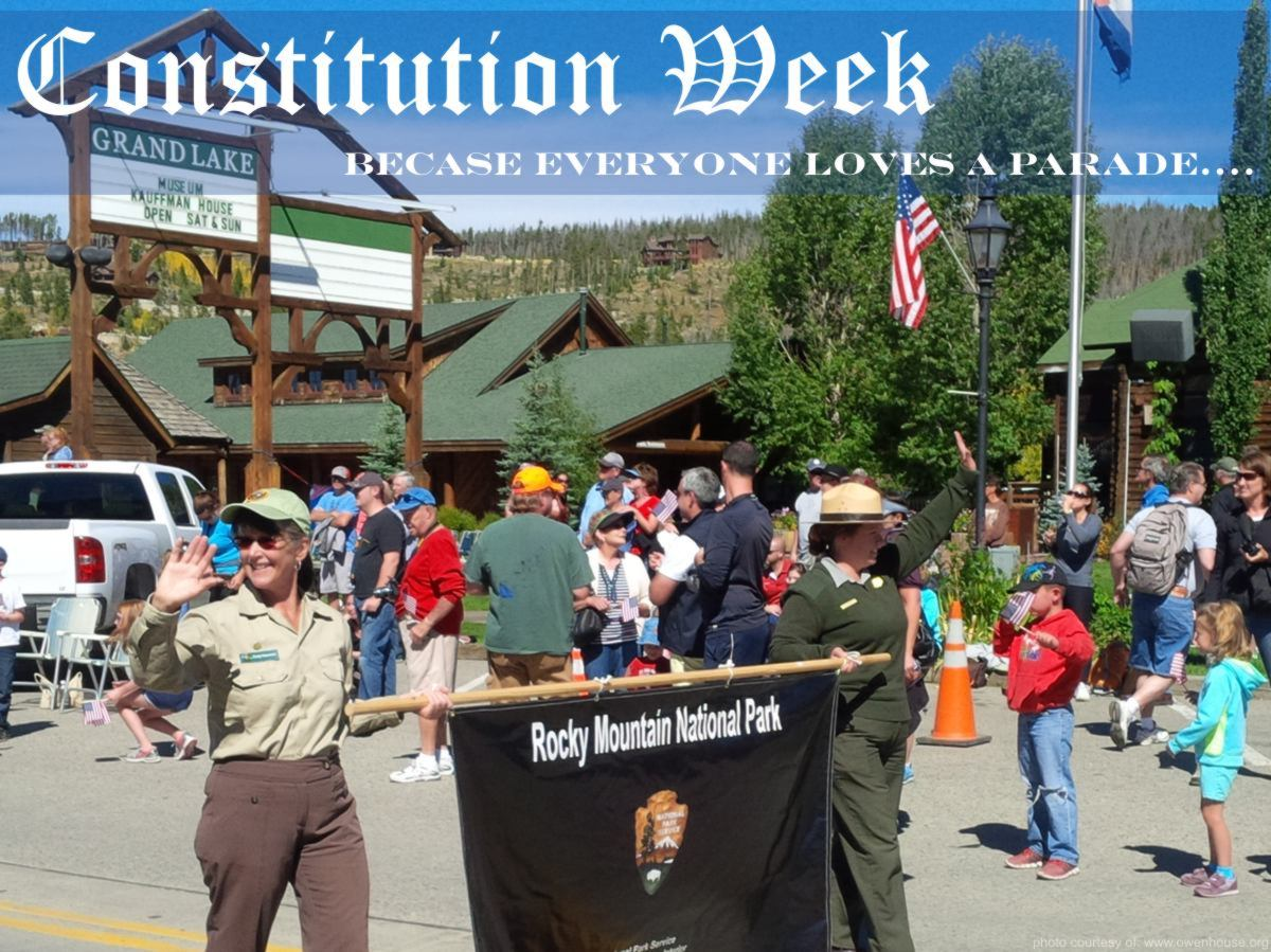 Slide 4 - Picture of the Constitution Week Parade of the Rangers from the Rocky Mountainal National Park taken in Grand Lake, Colorado - Now with text that would indicated that everyone loves a parade.