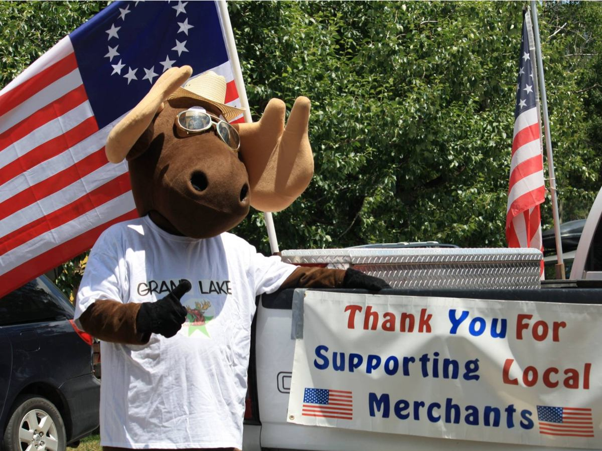 Slide 9 - Picture of the town mascot Bruce the Moose in support of our local merchants taken in Grand Lake, Colorado.