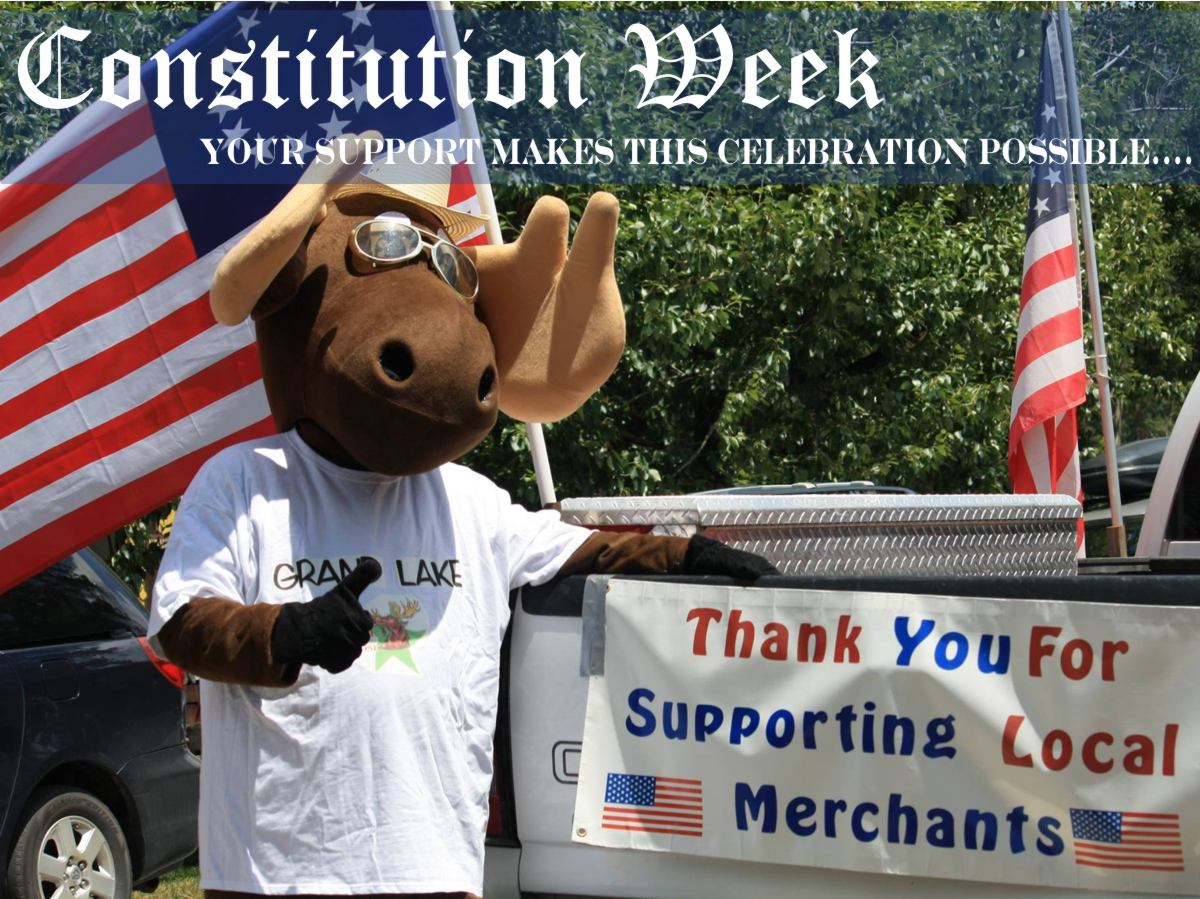 Slide 10 - Picture of the town mascot Bruce the Moose in support of our local merchants taken in Grand Lake, Colorado - Now with text that asks for everyone to support our local merchants.