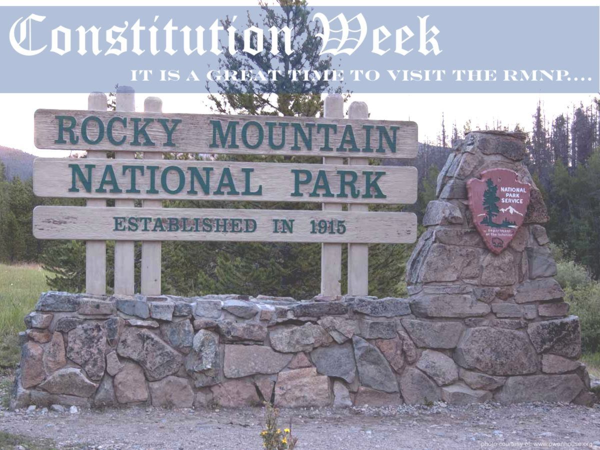 Slide 14 - Picture of the Rocky Mountain National Park Sign taken just outside Grand Lake, Colorado. - Now with text supporting Constitution Week and that this is a good time to visit the Rocky Mountain National Park.